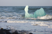 Iceberg Drifting In The Surf, ...
