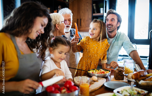 Happy family spending quality time together in the kichen - 308257557