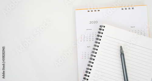 close up top view on  white calendar schedule background with pen and notebook t Canvas Print