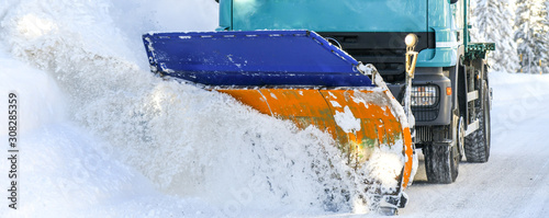 Fotomural Sow plough truck removing fresh heavy snow from road in winter season detail
