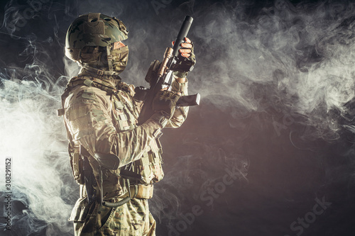 Photo  young military, soldier man holding gun wearing military wear, green camouflage