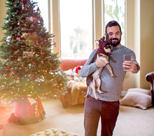 Man Taking Selfie With His Dog...