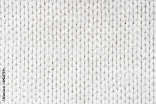 Photo White Knit Fabric Background. Wool Sweater Texture Close Up