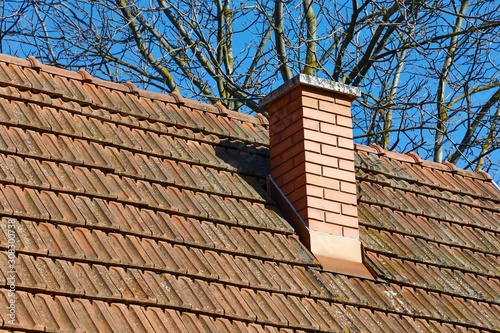 Fotografia Chimney on a roof of a house