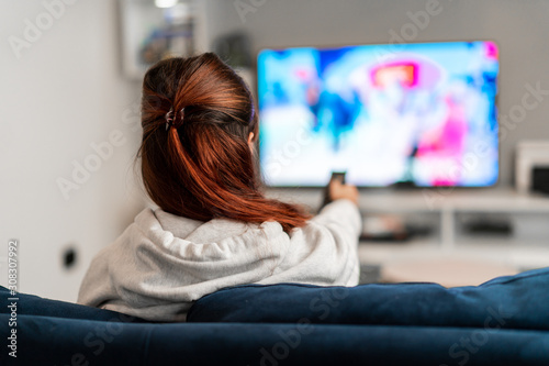 Girl watching tv programs on the sofa Canvas Print