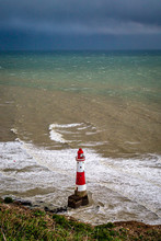 Beachy Head Lighthouse On The Sussex Coast On A Windy Winters Day