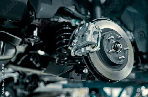 Fotomural  Disc brake of the vehicle for repair, in process of new tire replacement