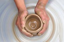 Hands Of Potter Creating A Jar
