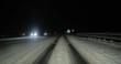 Winter driving with snowy road surface at night