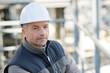 portrait of male worker wearing hardhat