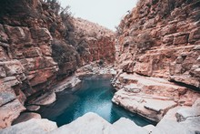 Small Lake Inside A Canyon Near The Rock Formations In The Paradise Valley In Morocco, Africa