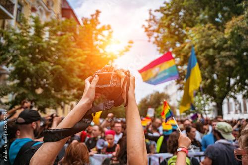 Correspondent takes photo during the Gay Pride parade Wallpaper Mural