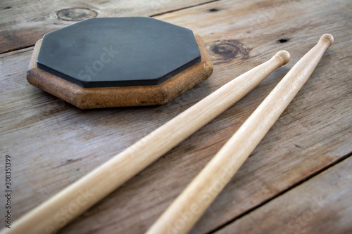 Cuadros en Lienzo  Drum practice pad and drumsticks