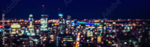 Abstract urban night light bokeh defocused background.