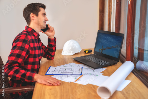 civil engineer at his Desk working with documents Canvas-taulu