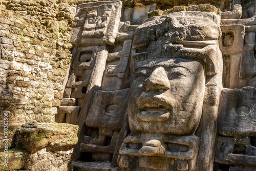 Photo Mayan Mask temple at Lamanai in Northern Belize.