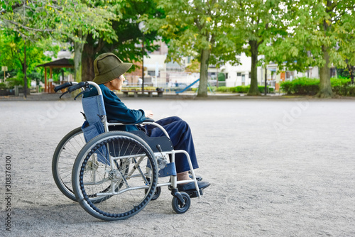 Fotografie, Obraz  A senior woman on a wheelchair and looking at the scenery