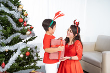 Happy Son Giving Christmas Gif...