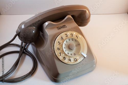 Old retro vintage rotary analogic telephone on a white background Canvas Print