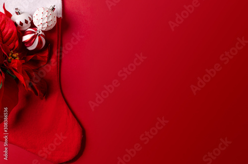 Christmas Stocking on red with Xmas decoration