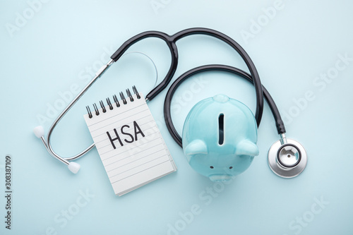 Fototapeta Health saving account, hsa concept on blue background obraz