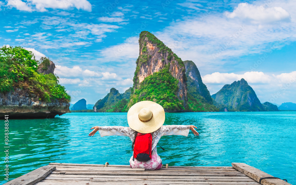 Fototapeta Traveler woman joy fun relaxing on wood bridge looking beautiful destination island, Phang-Nga bay, Travel adventure Thailand, Tourism natural scenic landscape Asia, Tourist on summer holiday vacation