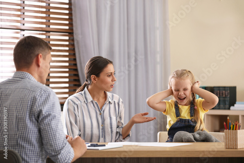 Fototapety, obrazy: Child psychotherapist working with little girl and her mother in office