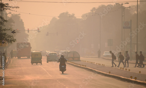 People walking in the streets of Delhi amidst smog