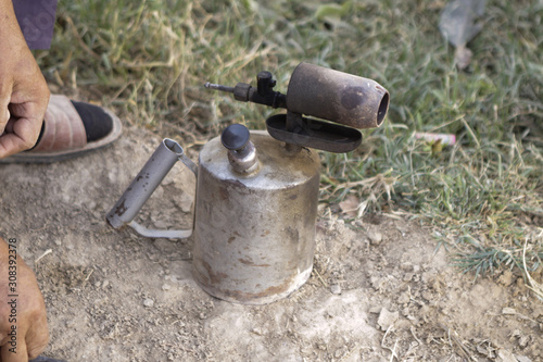 Old Soviet gas blowtorch is preparing for use Canvas Print