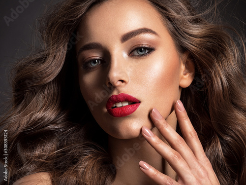 Obraz  Beautiful face of an attractive model with red lipstick. - fototapety do salonu