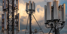 Base Stations And Mobile Phone Transmitters Against The Background Of The Evening Sky