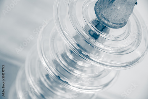 Photo Power line insulator made of glass, industrial electrical concept