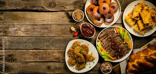 Selection of traditional hanukkah food for festive dinner - Potato Latkes, Apple Canvas Print