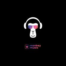 Monkey Enjoys The Music In Hea...