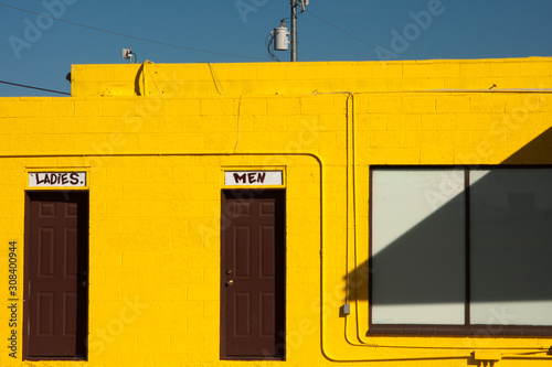 Foto op Canvas Route 66 A bright yellow building in Seligman, Arizona on Route 66.