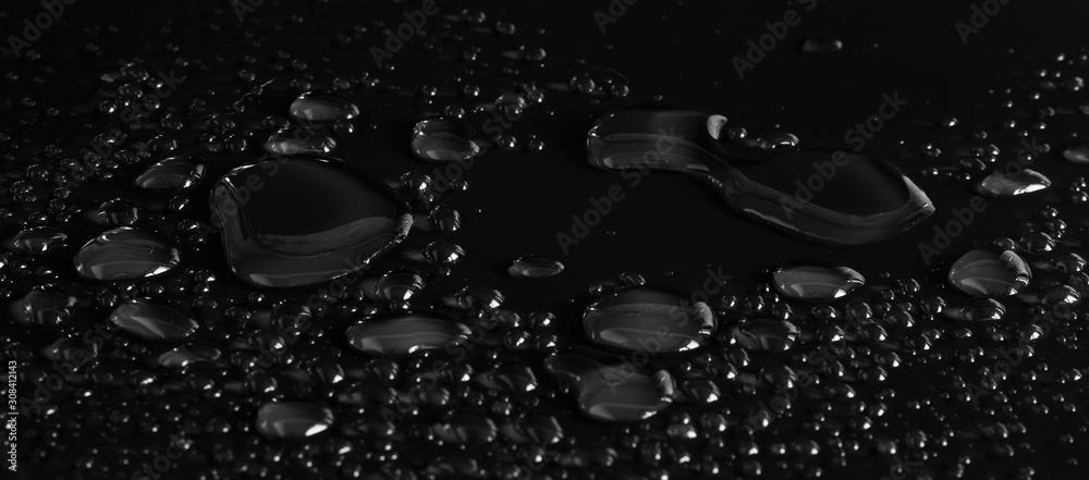 Fototapeta drops of water on a black background