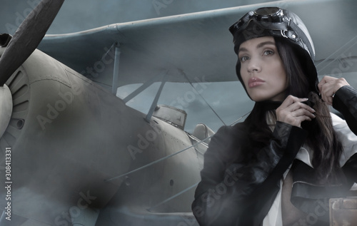 Photo Portrait of a beautiful brunette girl in a retro pilot suit