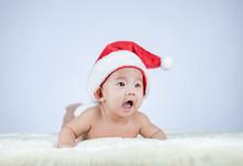 Christmas Portrait Of Cute Little Baby Wearing Santa Hat.