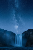 Waterfall at night under a beautiful milky way