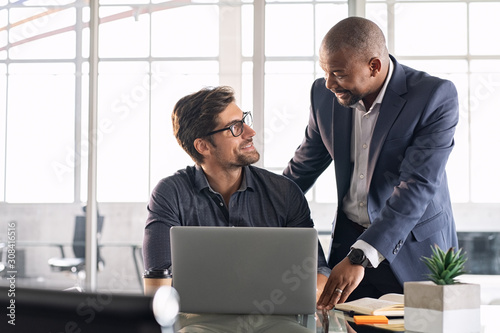 Mature executive helping new employee Canvas Print