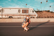 Leinwandbild Motiv retro style skater girl with a camper van in the background. california lifestyle