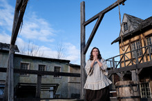 A Place For The Execution Of Criminals By Hanging In A Retro City And A Woman Begging For Mercy At The Gallows