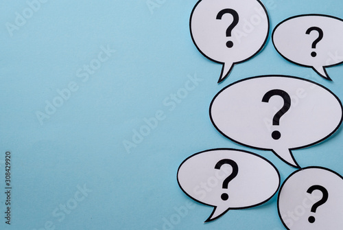 Photo Speech or thought bubbles with question marks