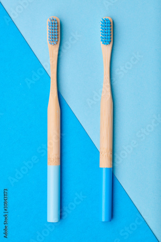 Valokuvatapetti Toothbrushes on blue background top view