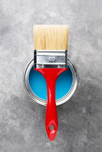 Can Of Blue Paint With Brush.