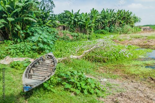 Canvas Print Small boat on a char (sandbank island) in Jamuna river, Bangladesh