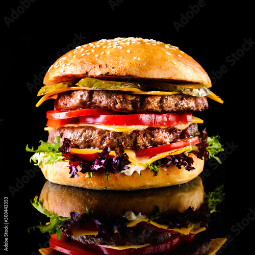 Fototapeta Homemade double cheese burger Black background obraz