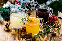 Selection Of Various Autumn Traditional Drinks, Set Punch And Mulled Wine On Christmas Rustic Background