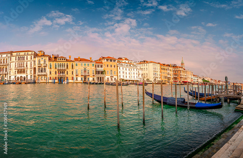 Spoed Fotobehang Gondolas Magical panoramic view during sunset over gondolas in Venice, Grand Canal and its historical center, Venice, Italy, summer time, blue sky