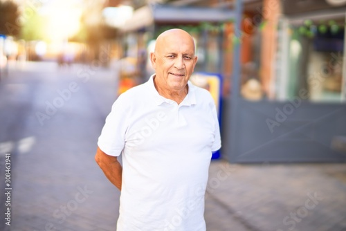 Fototapety, obrazy: Senior handsome man smiling happy and confident. Standing with smile on face at town street